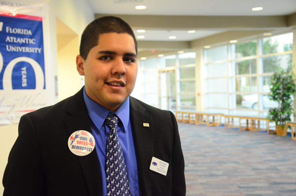 House Speaker and College Democrats President Boris Bastidas stands outside the Majestic Palm Room on September 24, greeting people as they arrive. Photo by Christine Capozziello.