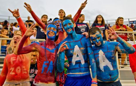 Fans were decked out in face paint and body point in support of the Owls. Photo by Charles Pratt.