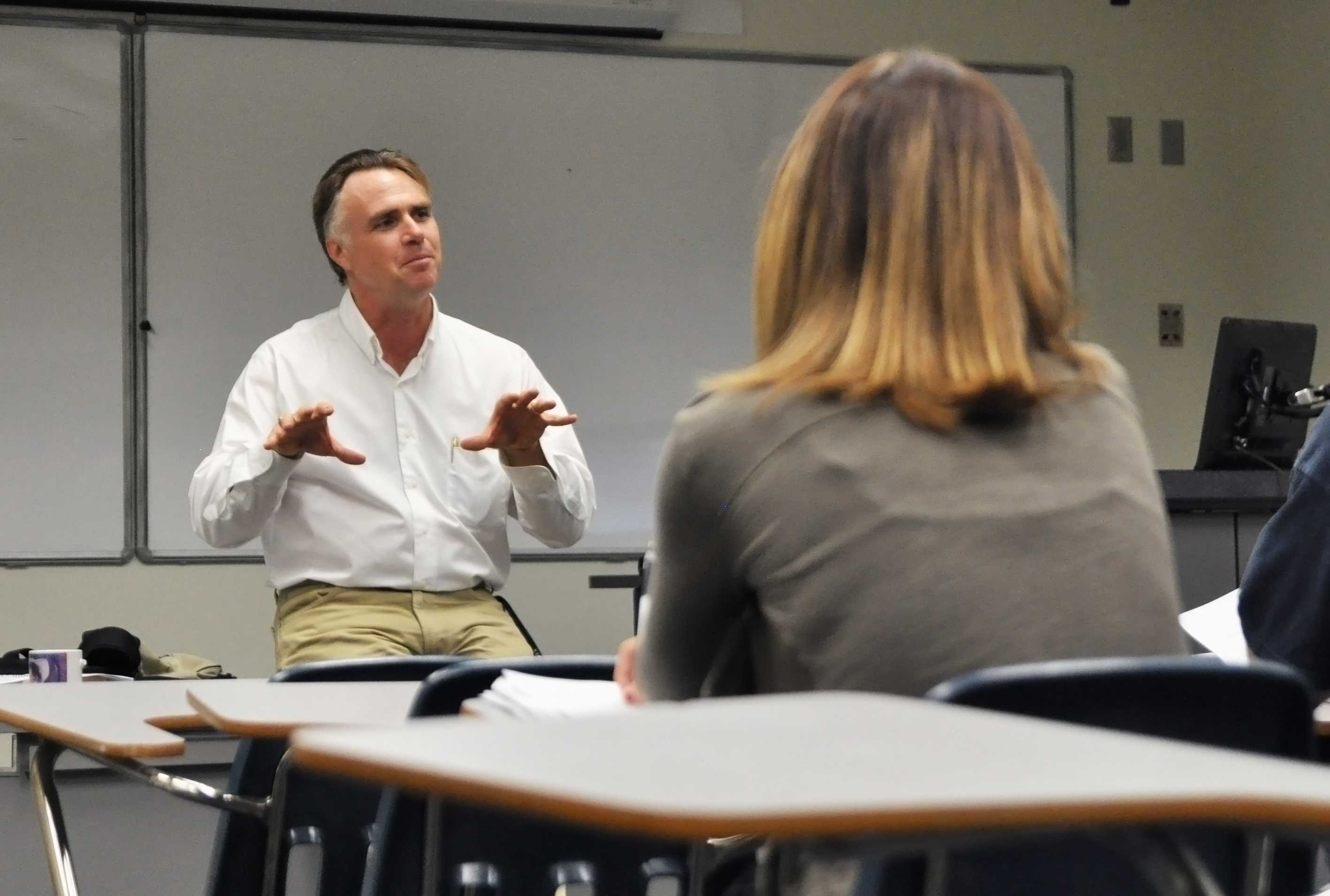 James Tracy introduces himself in his first class of the semester following the media coverage of his blog posts about the Newtown shooting. Photo by Michelle Friswell
