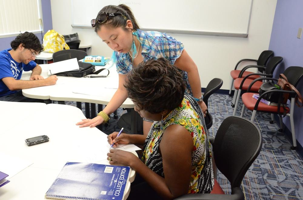 Supplemental instructors like graduate student Ning Ovathanasin help tutor undergrads in tough classes. Students asked SG to fund more SI leaders, which they did in March. Photo by Christine Capozziello