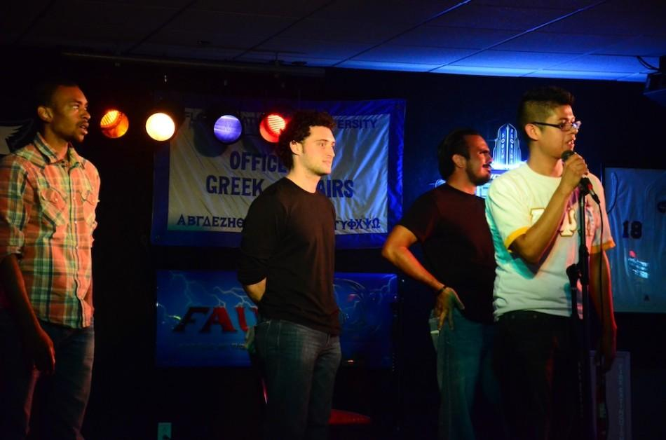 All+three+comedians+stand+on+stage+while+the+crowd+cheers+to+determine+the+winner.+Photo+by+Christine+Capozziello.