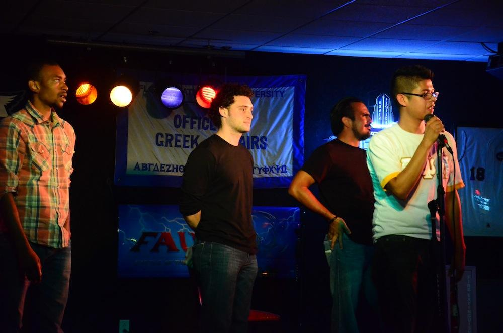 All three comedians stand on stage while the crowd cheers to determine the winner. Photo by Christine Capozziello.