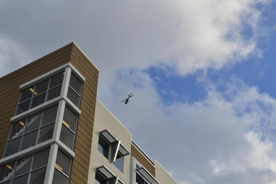 Channel 5 helicopters were seen flying over the Innovation Village Apartments on Thursday Nov. 29th during the campus lock down. Photo by Max Jackson.