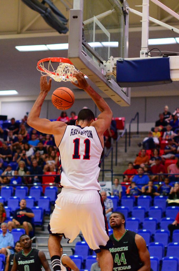 Justin Raffington converts an easy dunk. Raffington scored 27 points and grabbed 6 rebounds in the 78-76 loss.