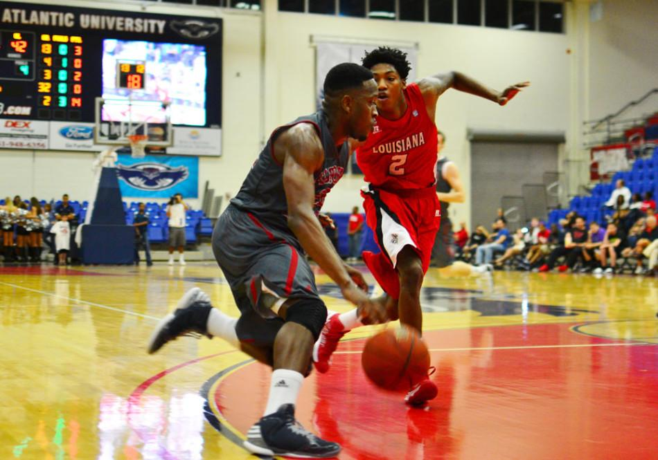 Greg Gantt drives to the basket against a Louisiana-Lafayette defender. Gantt finished with a game-high of 23 points in the Owls 75-70 win. Photo by Max Jackson.