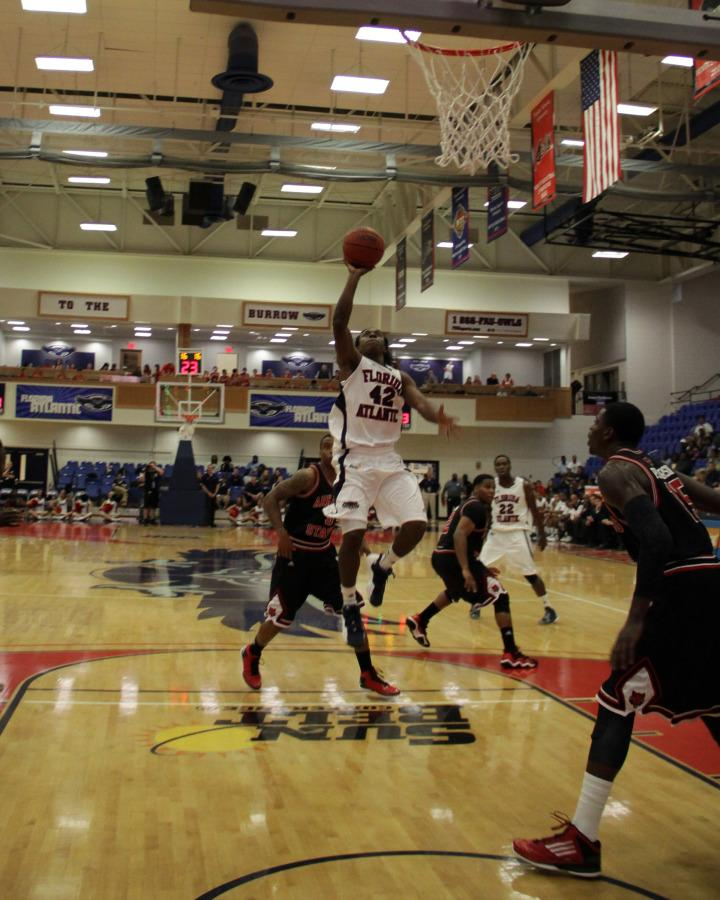 Freshman guard Stefan Moody lunges toward the hoop in the first half of Saturdays FAU basketball game. Photo by Michelle Friswell.