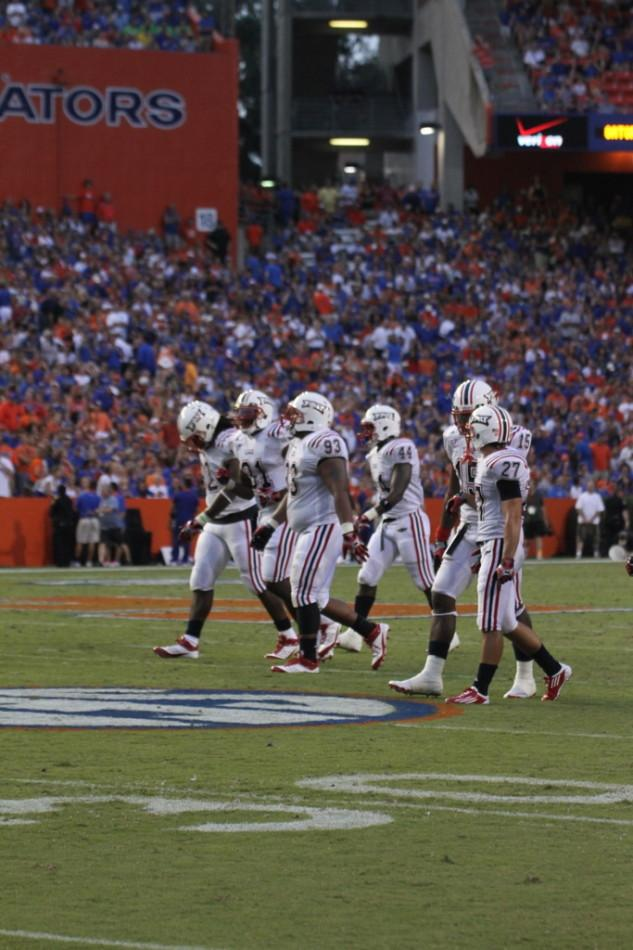 FAU's defense makes its way to the sidelines following a break in play versus the University of Florida. Photo by Lorenzo Ponce de Leon.