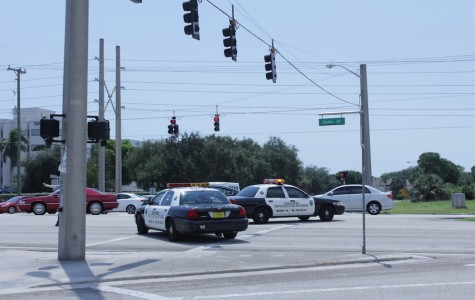 Boca Raton Police closed Glades Road following an accident involving a cyclist. They re-opened the road after a few hours. Photo by Allison Nielson.