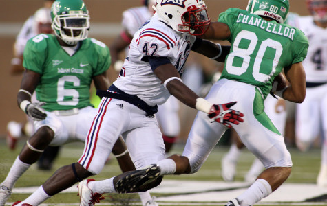Safety Damian Parms attempts to wrap up North Texas wide receiver Brelan Chancellor during FAU's 31-17 loss. The defeat drops FAU to 0-5 on the season, including an 0-2 record in conference play. Photo by Ralph Notaro.